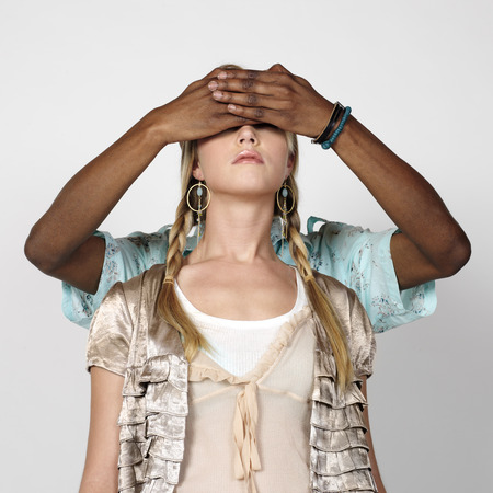 Man Covering Womans Eyes