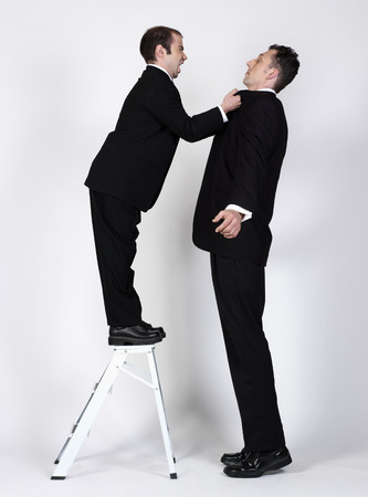 Short and Tall Businessmen LANG_EVOIMAGES