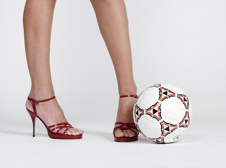Woman in High Heels and Soccer Ball LANG_EVOIMAGES