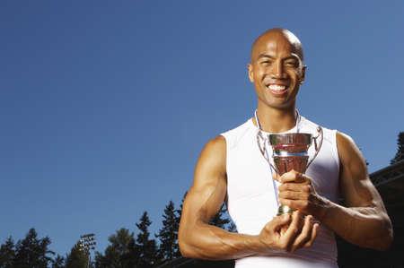 Athlete Holding Trophy LANG_EVOIMAGES