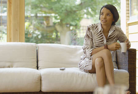 indian style sitting: Woman Sitting in Living Room