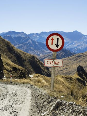 travelled: Road Sign on Dirt Road, Queenstown, South Island, New Zealand