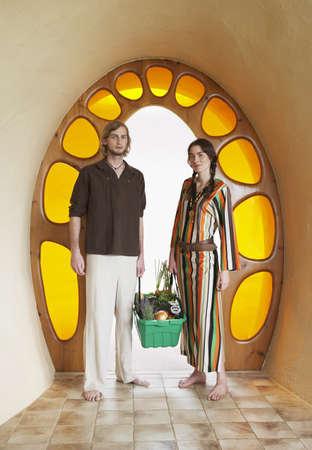 Portrait of Hippie Couple in Doorway LANG_EVOIMAGES