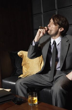 luxurious: Man with Cigar and Liquor LANG_EVOIMAGES