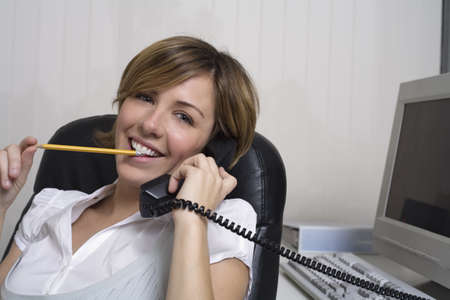 chewed: Businesswoman Using Telephone LANG_EVOIMAGES