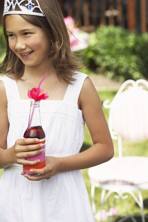Girl Holding Bottle of Soda Pop LANG_EVOIMAGES