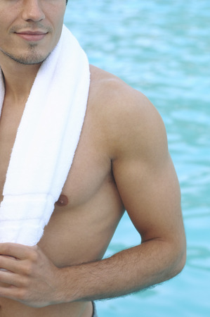 wetting: Man in Swimming Pool LANG_EVOIMAGES