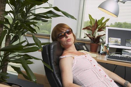 window view: Woman Suntanning under Office Lamp