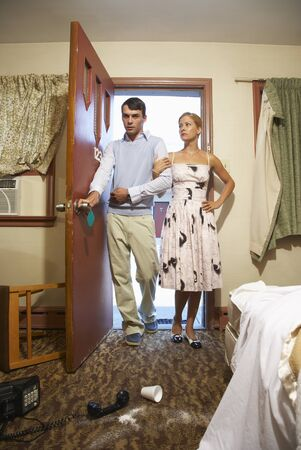 glower: Couple Entering Messy Motel Room