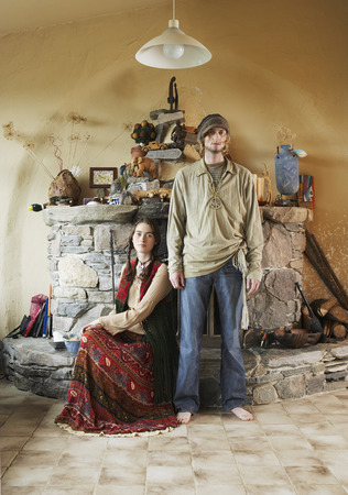 Hippie Couple in Front of Fireplace