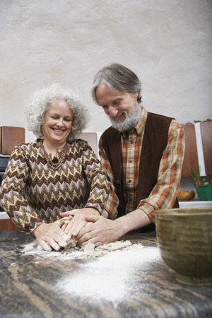 counter top: Couple Making Pastry in Kitchen