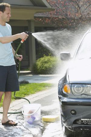 Man Washing Car LANG_EVOIMAGES
