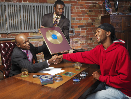 achievment: Record Executives Presenting Gold Record to Hip Hop Artist