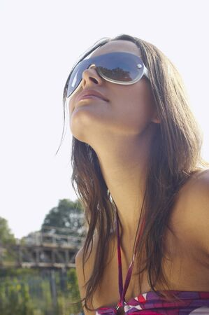 end of a long day: Woman in Sunglasses LANG_EVOIMAGES