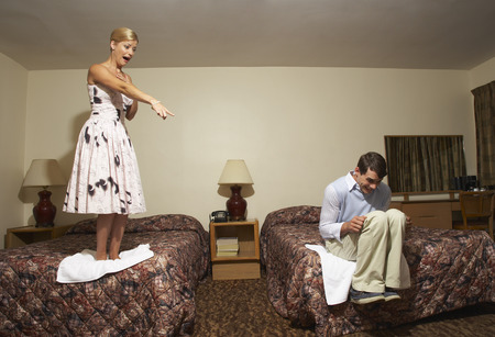 intimidated: Frightened Couple in Motel Room LANG_EVOIMAGES