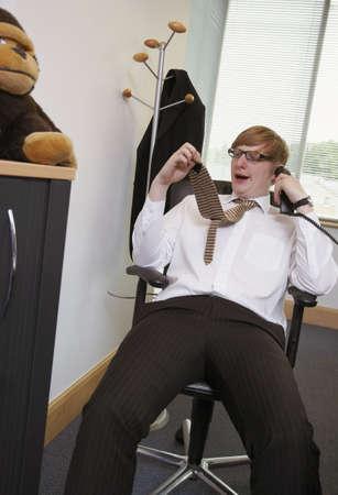 Businessman Yawning at Work LANG_EVOIMAGES