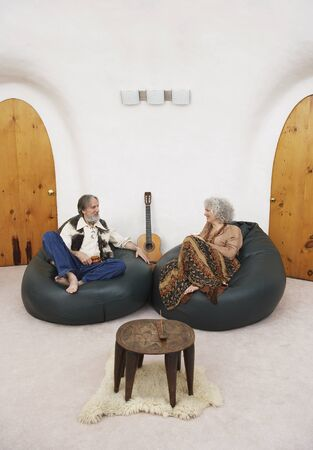 Couple Sitting in Bean Bag Chairs in Living Room