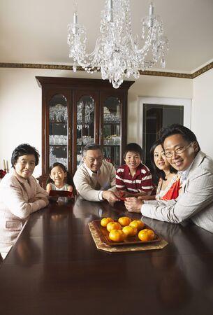 three generation: Family Portrait in Elegant Dining Room