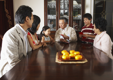 daughter in law: Family Sitting around Dining Table