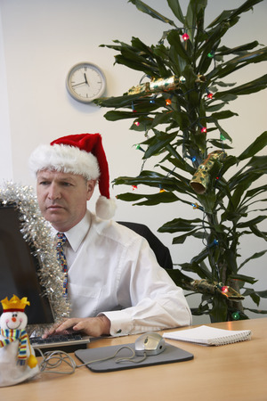 Businessman in Office with Christmas Decorations