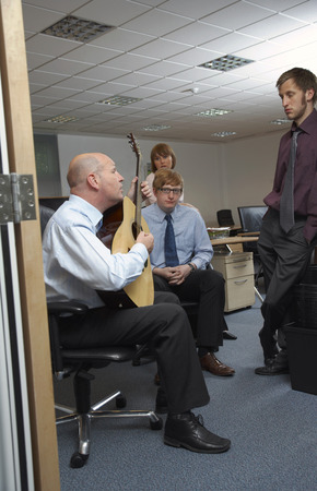 Manager Playing Guitar for Employees