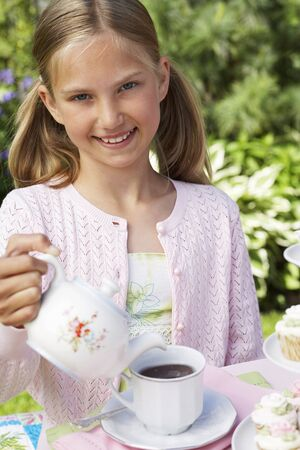 afternoon fancy cake: Girl Pouring Tea at Tea Party