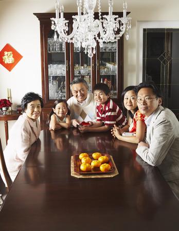 goodluck: Portrait of Family in Elegant Dining Room LANG_EVOIMAGES