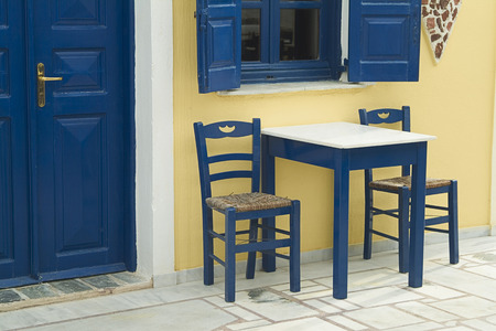 without windows: Table and Chairs Outside of Restaurant, Oia, Santorini, Cyclades Islands, Greece LANG_EVOIMAGES