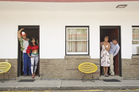 comparable: Two Couples in Motel Looking at Each Other