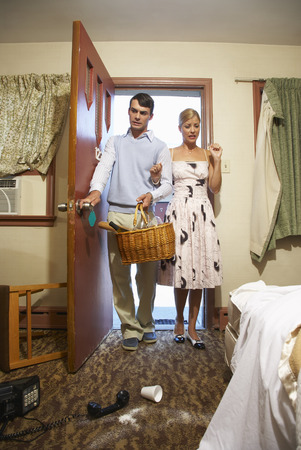 disapprove: Couple Entering Messy Motel Room