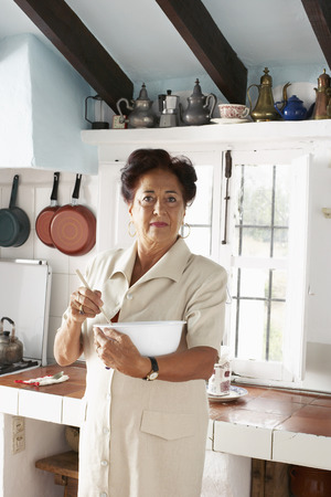 counter top: Woman with Mixing Bowl in Kitchen