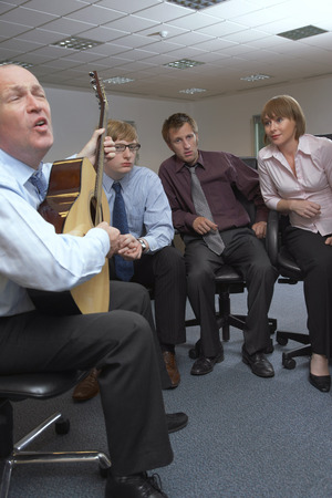 egoistic: Manager Playing Guitar for Employees