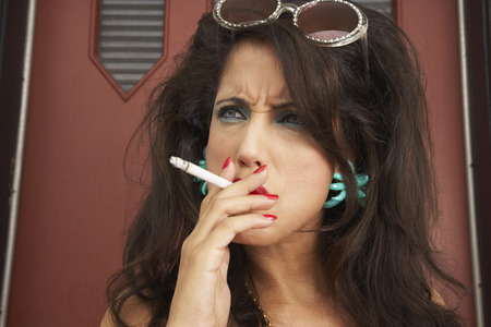 glower: Portrait of Angry Woman Smoking