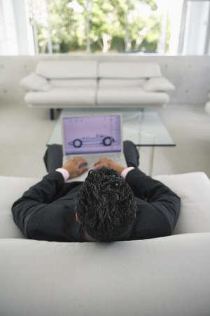 family sofa: Man Using Laptop