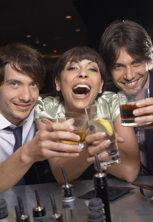 expressing: Businessmen and Woman in Bar LANG_EVOIMAGES