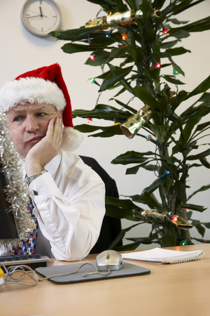 scrooge: Businessman in Office with Christmas Decorations