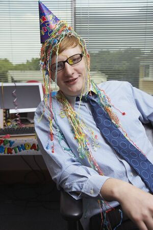 Portrait of Office Worker with Birthday Decorations