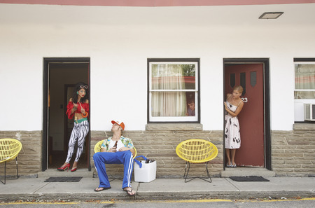 disapprove: Couple Looking at Other Couple at Motel