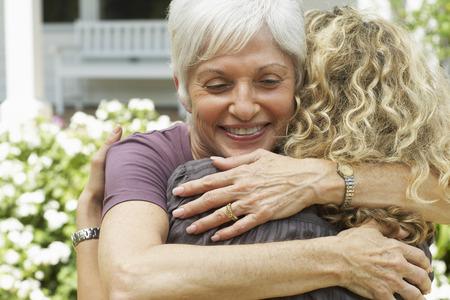 maternal: Mother and Daughter Hugging
