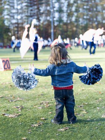 pom: Little Girl Cheerleading LANG_EVOIMAGES