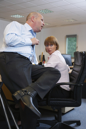 Manager Talking to Employee LANG_EVOIMAGES