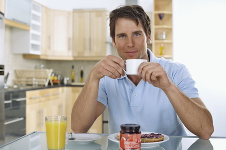 front desk: Man Eating Breakfast