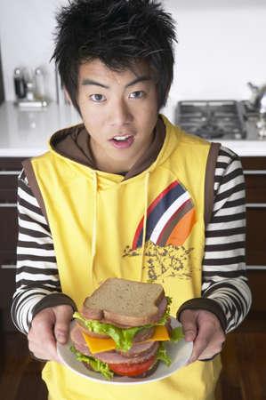 teenaged boy: Teenaged Boy with Sandwich