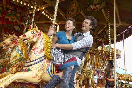 sitting on the ground: Couple on Merry-Go-Round, Carters Steam Fair, England