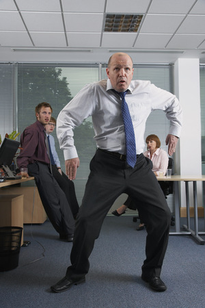 Manager Dancing for Staff in Office