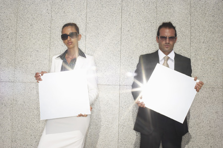 woman mirror: Business People Holding Mirrors