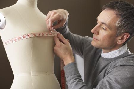 tailored: Man Measuring LANG_EVOIMAGES