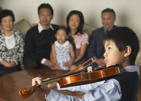 front desk: Family Watching Boy Play Violin