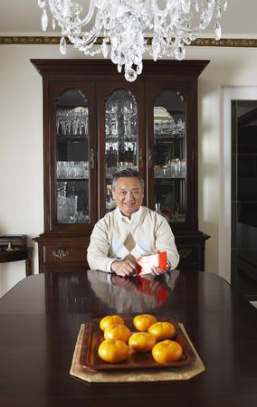 goodluck: Portrait of Man in Elegant Dining Room