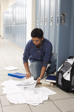 Student Dropping Notes by Locker
